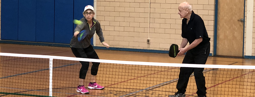This Is A Photo Of 2 Seniors Playing Pickleball At The Springfield JCC