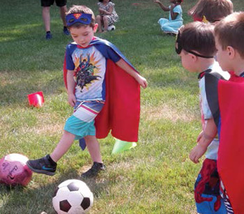 This is a photo of children playing soccer at the Springfield JCC Summer Camp